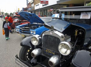 <p>A good crowd gathered in downtown Scottville Saturday for the annual Summerfest Car Show.</p>