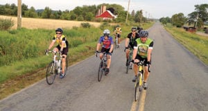 <p>Tammy Martin, Scott Sitler, Ed Ekstrom, Henrik Lidman, Tim Martin and Roger Chappel are among those leading the way among bicyclists on the 100-mile route of Saturday's HELP Ministry Make a Difference ride on West Victory Drive. The event — with 14, 20, 44 and 62 miles as well — raised more than $30,000 to help community members in tough times.</p>