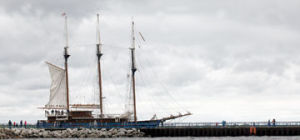 <p>The tall ship Peacemaker sails out of Ludington Harbor Tuesday heading for Chicago.</p>