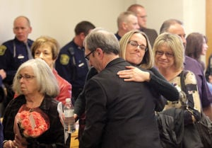<p>Michigan State Police Trooper Paul Butterfield's fiancee, Jen Sielski hugs Mason County Prosecutor Paul Spaniola following Eric Knysz sentencing Tuesday in 51st Circuit Court, for killing Trooper Butterfield in 2013.</p>