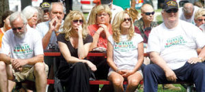 <p>People look on Thursday during the opening ceremony speech by Vietnam veteran Rick Plummer at Ludington City Park. Plummer's speech brought tears to many veterans attending the ceremony.</p>