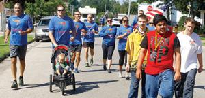 <p>Members of local law enforcement along with athletes from Special Olympics participate in the Law Enforcement Torch Run for Special Olympics in Michigan. The 5K run covered 3.2 miles and raised money and awareness for Special Olympic in Michigan.</p>