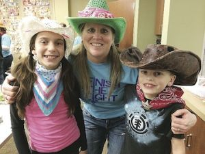 <p>Taylor, Lisa and Jack Mackowicki pose in their cowboy hats Monday night, the American Cancer Society's Relay for Life of Mason County kickoff. This year a kids Relay Recess is being planned.</p>
