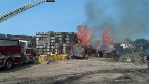 <p>Firefighters and equipment from five departments, including Ludington's aerial truck, were requested to fight the apple box fire at Indian Summer Friday, July 18, 2014.</p>
