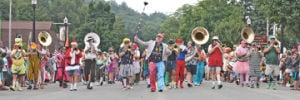<p>George C. Wilson leads the Scottville Clown band as they make their way south along Hancock Street during the Pentwater Homecoming Parade Saturday, Aug. 16, 2014.</p>