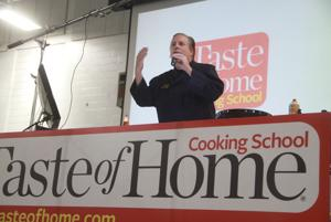 <p>Guy Klinzing opens the 2014 Ludington Daily News Taste of Home Cooking School show Tuesday, September 16, 2014 with a song. He's known as