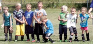 <p>Players get excited during Ludington soccer camp this week.</p>