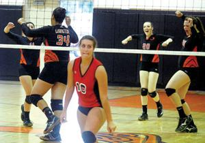 <p>Ludington volleyball players celebrate a point during Tuesday's home volleyball match against Fremont. Ludington defeated Fremont 25-11, 25-22 and 25-19.</p>