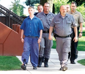 <p>Two Michigan Corrections Officers and local law enforcement escort Sean Phillips out of the Mason County Courthouse this Thursday. July 31, 2014 after his preliminary hearing on a charge of open murder in the case of his missing daughter .</p>