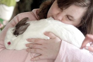 <p>Helen hugs a rabbits at the Circle Rocking S Children's Farm Tuesday, April 15, 2014 during an Easter celebration. This weekend there are many more egg hunts and events.</p>