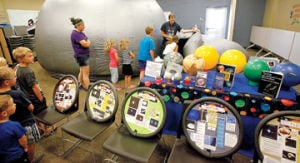 <p>Rod Bisher of Star Dogs Astronomer had his planetarium available for children at the Ludington Library Monday. The program was brought to the library by the Friends of the Library and Dynamic West School Assemblies. Inside the dome inflatable structure, images and movies are projected on the walls.</p>