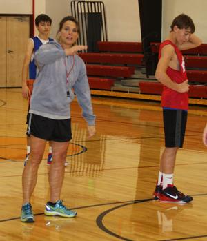 <p>Kara Triplett stresses a point during boys basketball practice this week.</p>