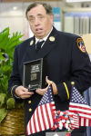 New York firefighter presents piece of World Trade Center