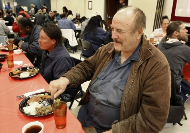 sioux city gospel mission serves plates piled high with food