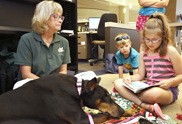 Read to Me summer reading program with S.T.A.R.S canines