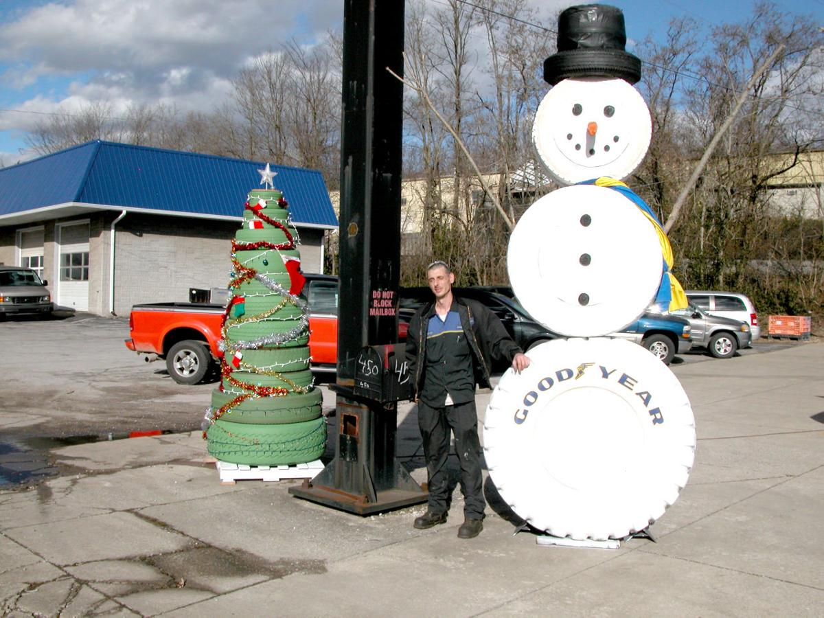 A creative way to say merry christmas news somerset for Snowmen made from tires