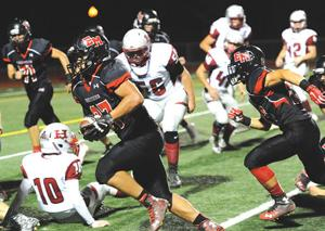 """<p>El Mo's Ryan Fernandez scooped up a Healdsburg fumbled and returned it five yards for a touchdown in Friday's 42-26 loss to the Greyhounds in the first annual """"Battle for the Paddle"""" at Windsor High School.</p>"""
