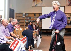 """<p>Bill Olzman, president of the WSCTA, declares """"We are purple!"""" before a crowd of West County teachers and students who came out in force to protest proposed contract changes at a WSCUHSD Board of Trustees meeting in the El Molino library on Wednesday, Feb. 18, 2015.</p>"""