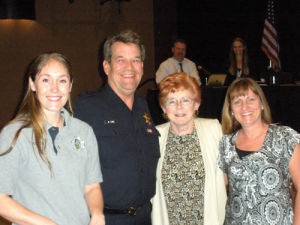 <p>Caitlin Jensen (left) and  Ann Turek (far right) received a proclamation on behalf of emergency dispatchers in the community for their work. Pictured with them are Chief of Police Mark Tuma and Mayor Carol Russell.</p>