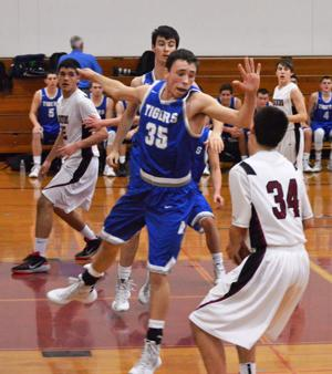 <p>Analy's Travis Holmes (35) put the clamps on his man in a January clash against Healdsburg. The Tigers will host the Hounds in a rematch on Feb. 3.</p>