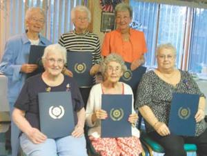 Auxiliary fetes longtime members