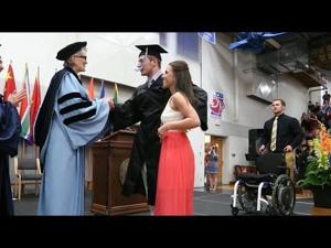 College student paralyzed after football injury walks at graduation