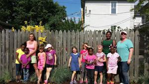 Troop 323 plants garden at Neighborhood Service Center