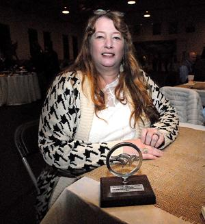 """<p>Kim Newcomb received an award Friday evening during the Waterfowl Festival's volunteer """"Thank You"""" party for her service on the Board. Newcomb has organized and run the Artifacts Exhibit at Easton High School during the Festival since 1996.</p>"""