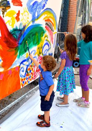 <p>Youngsters create artwork at the painting station across the street from the Dorchester Center for the Arts during the Dorchester Showcase.</p>
