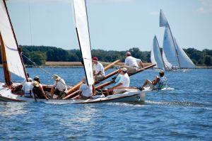 CBMM offers canoe race viewing aboard buy boat