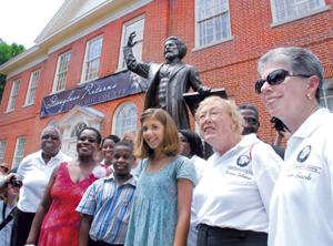 Douglass Society members with statue