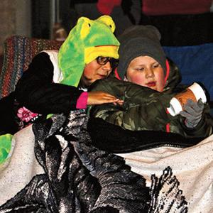 Area residents pack downtown streets to watch Christmas parade