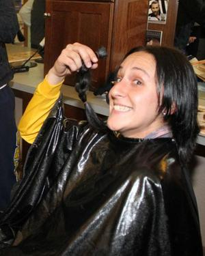 Cougar volleyball coach donates hair to Locks of Love