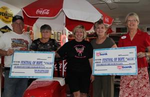 Cozad scoots for loot for Festival of Hope-checks