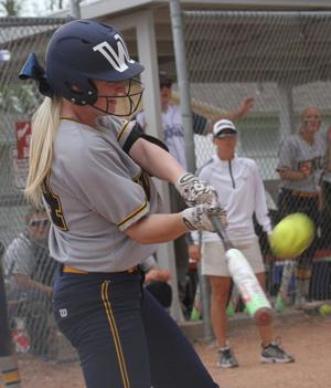 <p>Western Nebraska Community College's Whitney Fields hits during the Region IX championship series on Saturday afternoon in Sterling, Colo. The Cougars beat McCook Community College twice to capture the regional title.</p>
