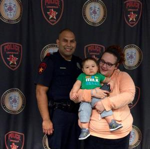 <p>Lewisville police officer Jeremy Reyna has received a lot of positive attention since buying a new car seat for Kyler Lacey. Recently Nicole Dean, Lacey's mother, got another chance to thank Reyna at the Lewisville Police Department.</p>