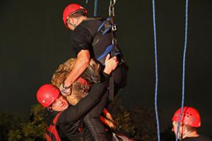 <p>A swift-water rescue crew pulls a man and his dog to safety early Friday morning in McKinney.</p>