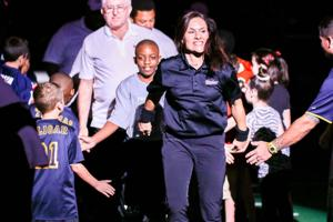 <p>Jen Welter, front, will coach inside linebackers for the Arizona Cardinals this preseason after spending two years as a player and coach with the Texas Revolution. </p>