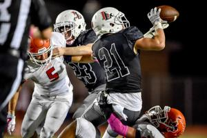 <p>Lovejoy senior safety Dakota Michaels (21) had an interception with 8:50 to play in the Leopards' 27-20 win over McKinney North Friday night.</p>
