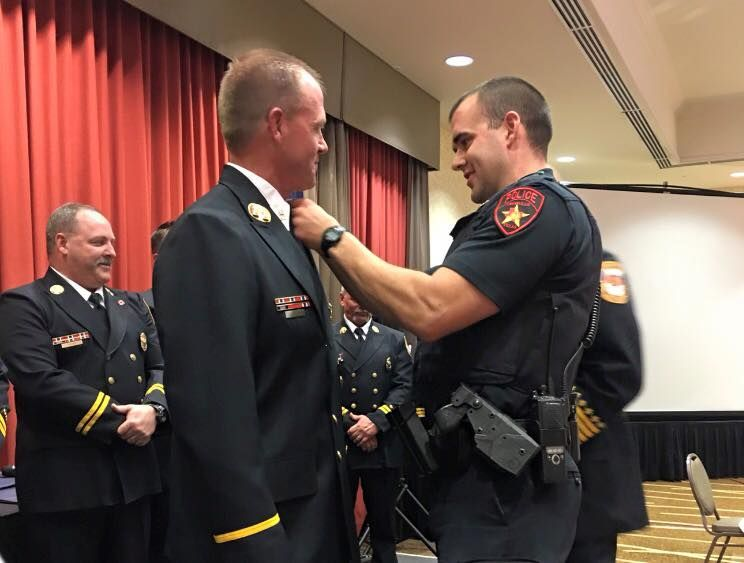 banquet fire lewisville police department firefighter bannister codie awards bays promoted rank insignia officer starlocalmedia glen recently captain son
