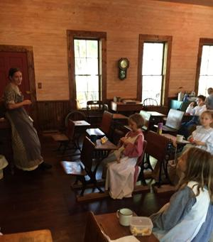<p>Prairie Adventure Camp participants learn about historic Collin County life inside the Wilmeth Schoolhouse at Chestnut Square Historic Village in McKinney. Jaymie Pedigo, the village's new executive director, hopes to enhance its camps and other on-site events.</p>