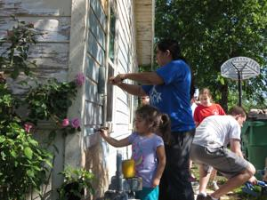 """<p>Residents and volunteers team up to renovate a house off Gerrish Street last Saturday as part of """"Go and Be,"""" a church-led revitalization project in the Wilcox neighborhood on McKinney's east side.</p>"""