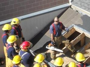 <p><span>Plano firefighter Mike Boatman, center, talks to a group of Fire Academy Class 51 students on the roof of the strip center portion of Collin College's former fire training facility back in 2011. Construction on a new, upgraded public safety training facility is set to begin within a year.</span></p>