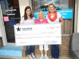<p>Pictured are, from left, Lisa Tyler with Grande; J.B. (Babs) Troutman, BGCNCT president and chief professional officer and Lori Salisbury with Grande.</p><p></p>