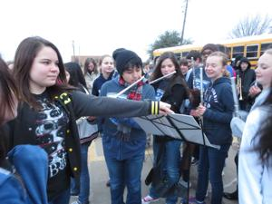 <p>Emily Thompson, 12, holds the music for her Cockrill Middle School band mates Thursday during a surprise for Thompson, diagnosed Jan. 21 with severe asplastic anemia.</p>