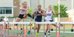 <p>Flower Mound Marcus hurdler Bridget Tobias, left, swept the 100- and 300-meter hurdles Saturday at the District 5/6-6A area meet.</p>
