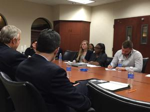 <p>Drew Howard, of H&S Manufacturing Co., left, and John Klitsch, of Lake Pointe Medical Center, talk to Sara Edwards, Tara Davis, Jake Johnson and other Young Entrepreneurs Academy students about how to succeed in business.</p>