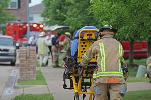<p>A woman is rolled out to an ambulance in the aftermath of a house fire Thursday afternoon in the 500 block of Rocky Springs Drive in McKinney. Abrar Khan, 55, died on scene and his wife, Talat Khan, 47, later died at the hospital.</p>