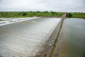 <p>Lewisville Lake began an uncontrolled spill about 2 p.m. May 24. The sight has attracted visitors all week.</p>