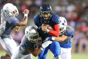<p>Allen senior Seth Green (with the ball) and the Eagles are undefeated in District 6-6A play thus far.</p>